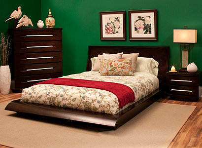 deep green walls will set the tone while floral prints and an eclectic assortment of vases will help tie your room together